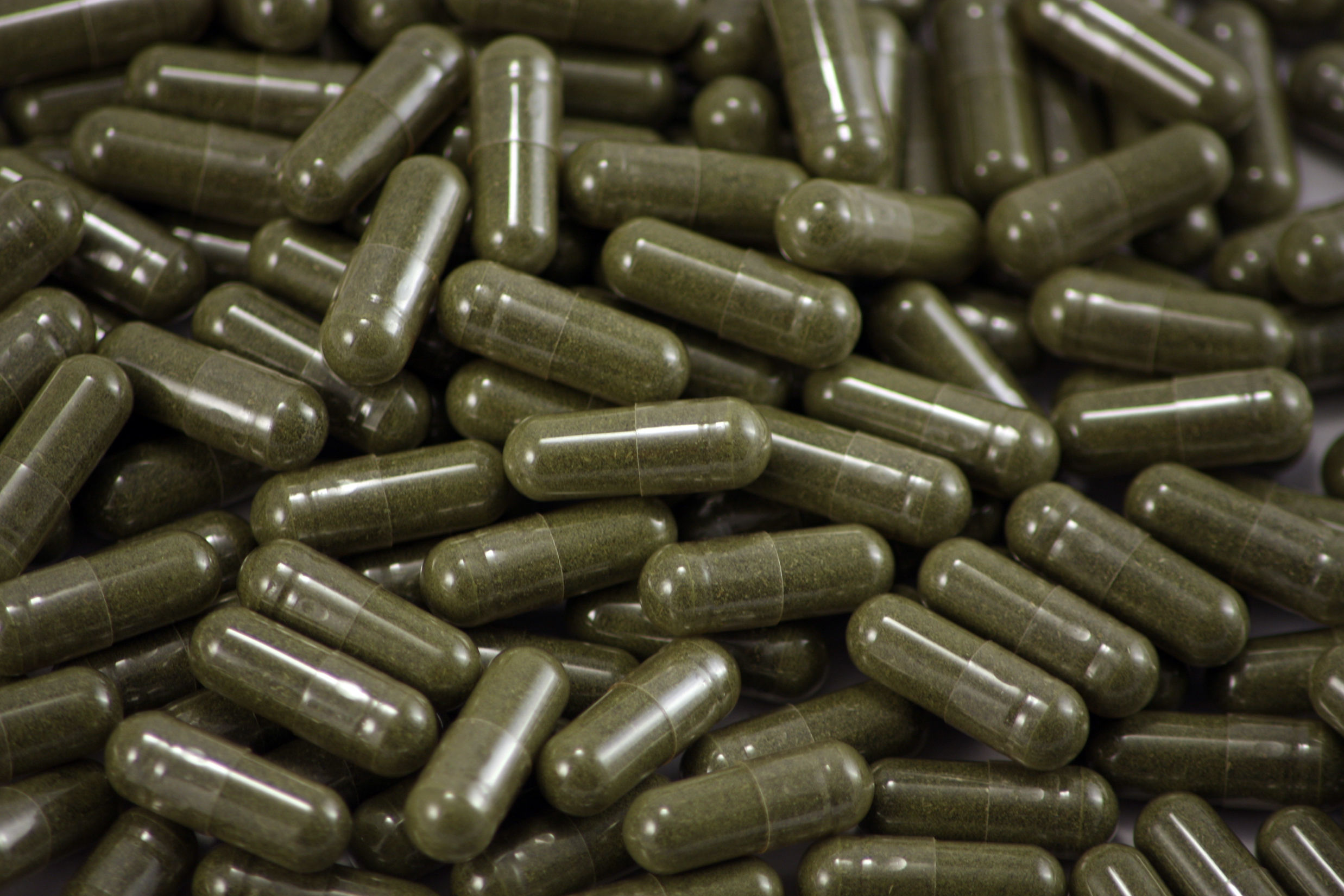 dark green herbal capsules